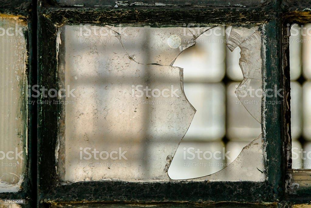 Broken Window in Abandoned Building stock photo