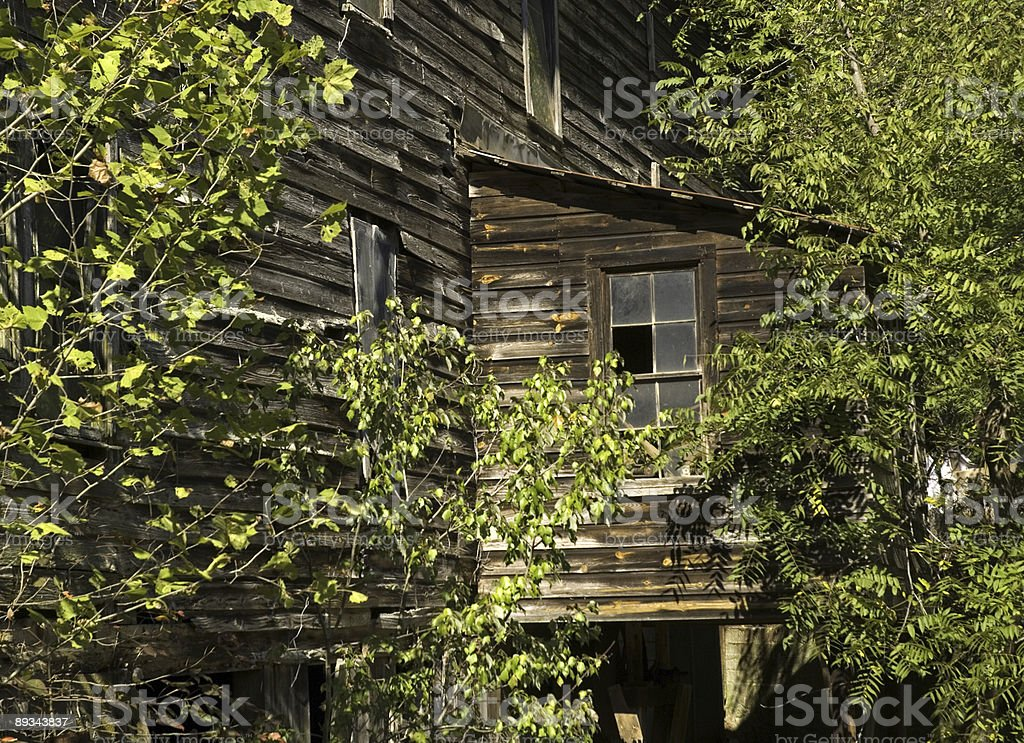 Broken Window on an Old Grist Mill royalty-free stock photo