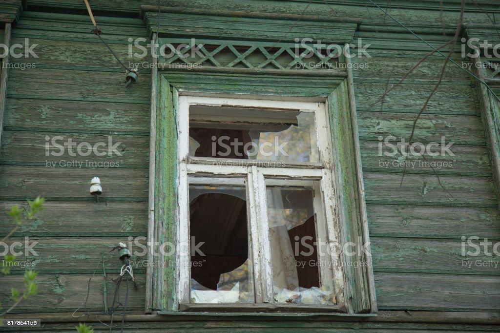 Broken window rural house background stock photo