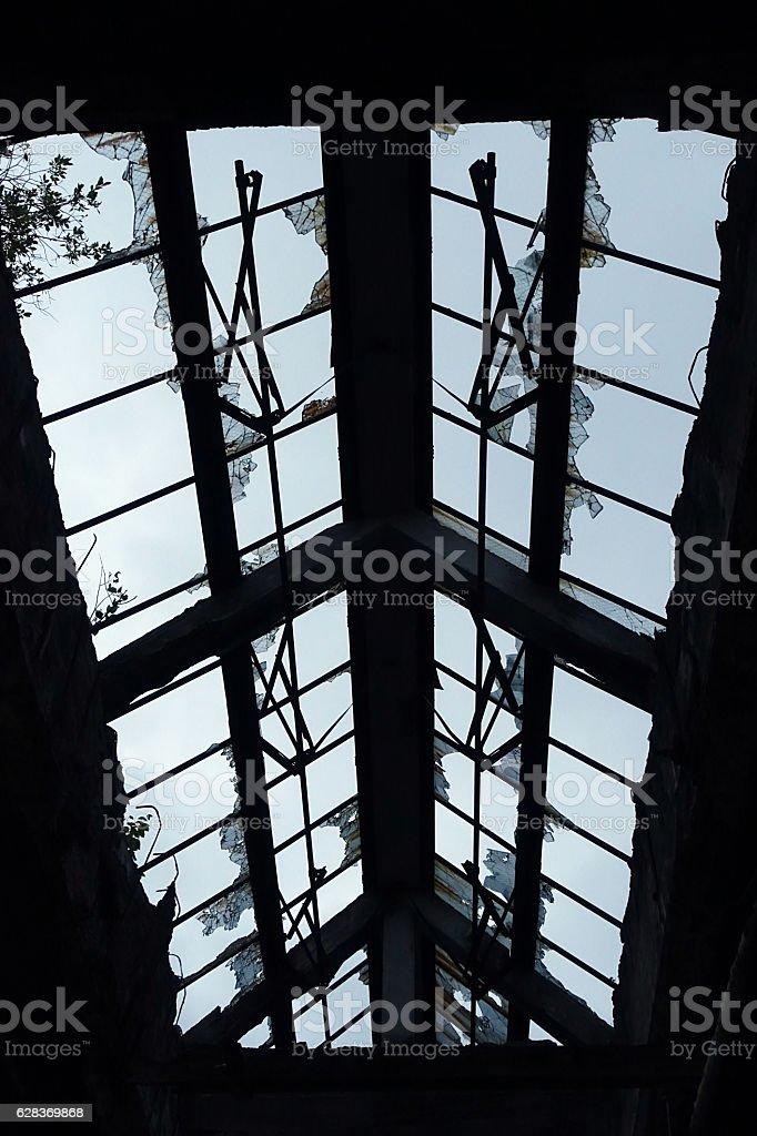Broken Windows in an Abandoned Building stock photo