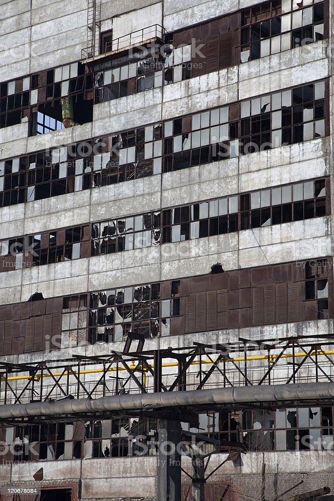 Broken windows in old industrial building royalty-free stock photo