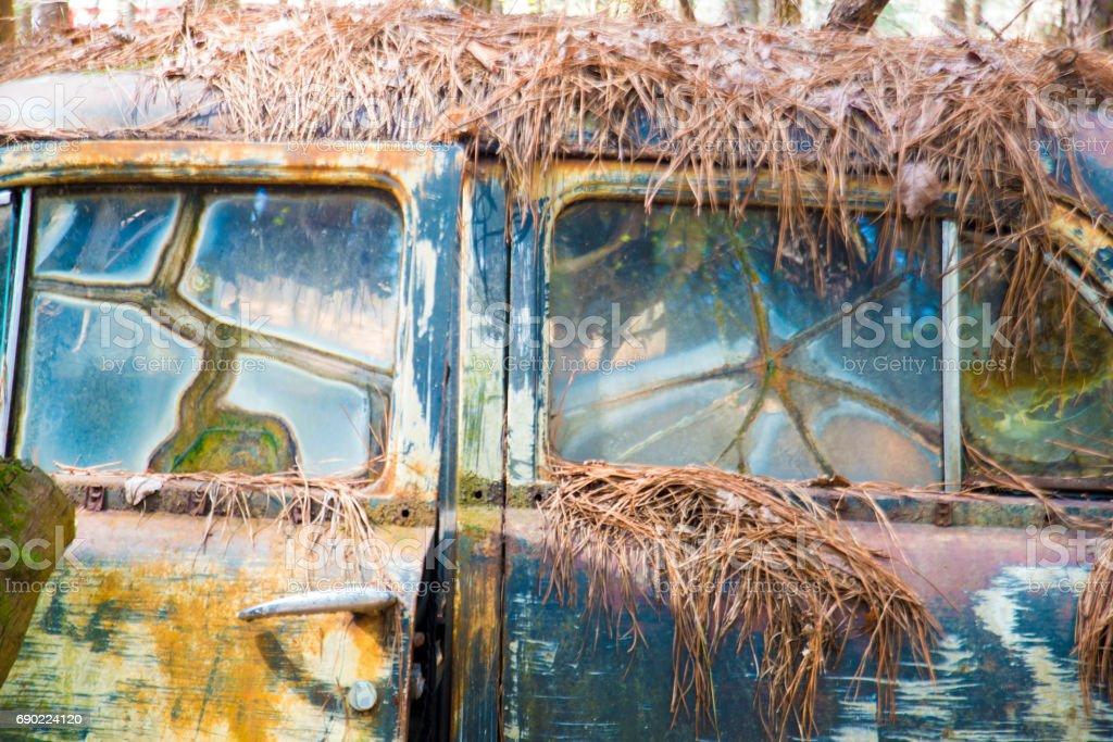 Broken windows in vintage rustic car. stock photo
