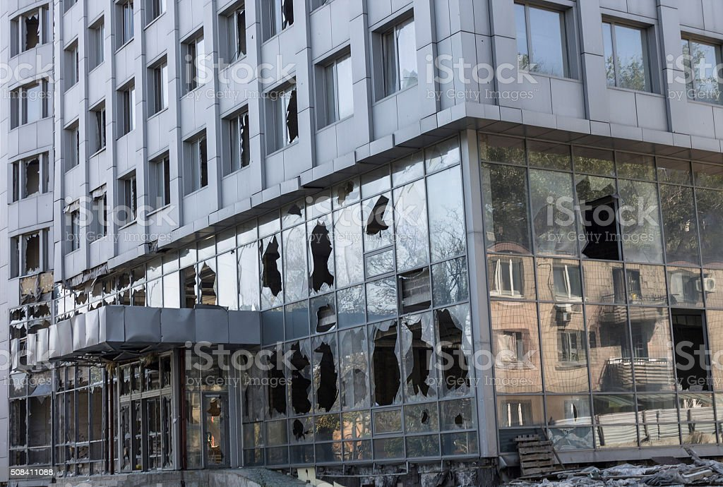 Broken windows of weapons falling into the Donetsk stock photo