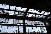 Broken Windows Streaked with Rust