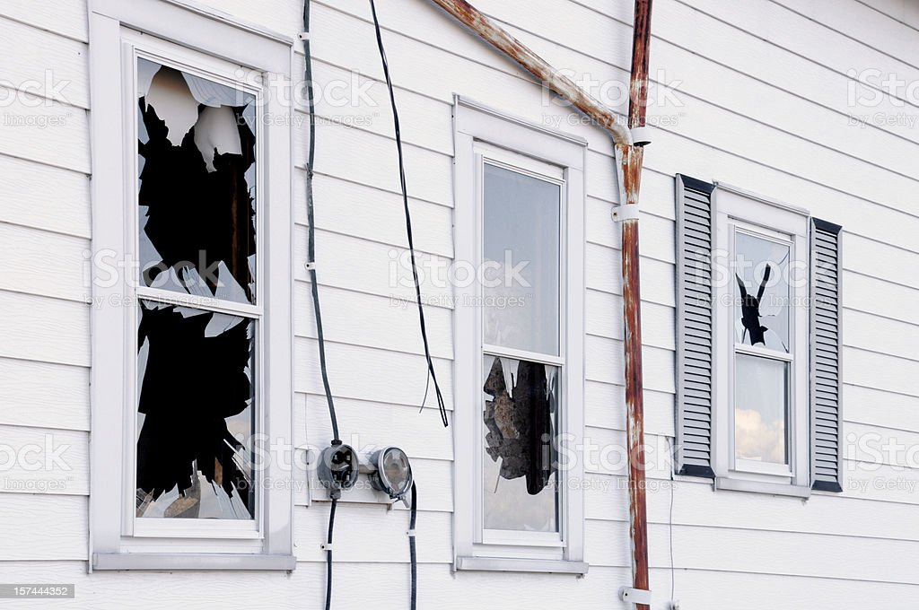Broken Windows; Vandalism, Disaster, Wind or Earth Quake Damage royalty-free stock photo