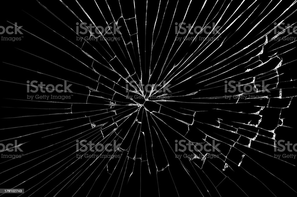 A broken windshield glass on a black background stock photo