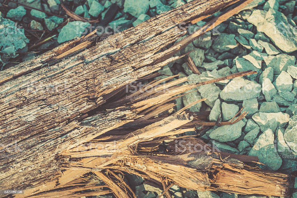 broken wood lumber with sharp spill in rock background. stock photo