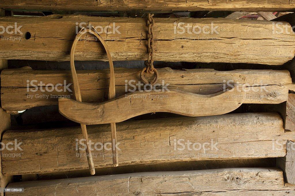 Broken Yoke hanging on a rough wooden wall stock photo