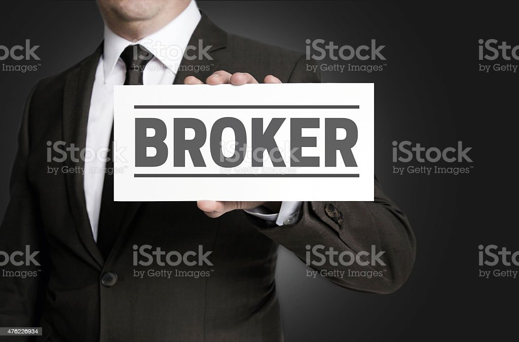 Broker sign is held by businessman stock photo