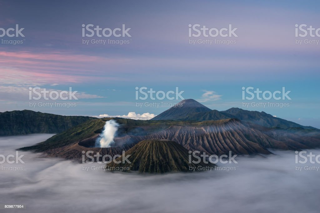 Bromo, Batok, and Semeru volcano mountain in a beautiful morning with sea of mist, Java, Indonesia stock photo
