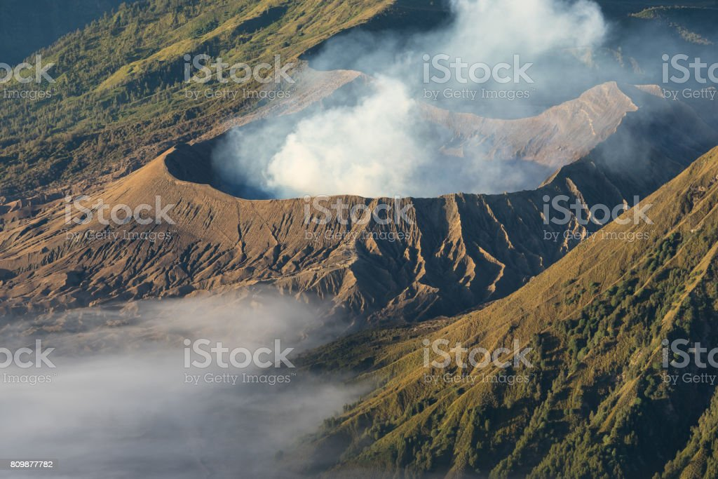 Bromo volcano moutain crater in a morning with mist, East Java, Indonesia stock photo