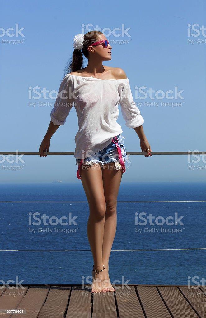Bronced Brunette Girl in Denim Shorts. Beauty Long Legs royalty-free stock photo