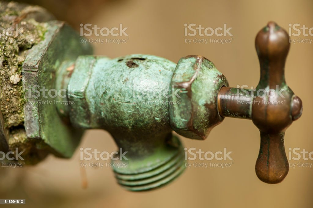 Bronze and Patina Copper Water Spigot stock photo
