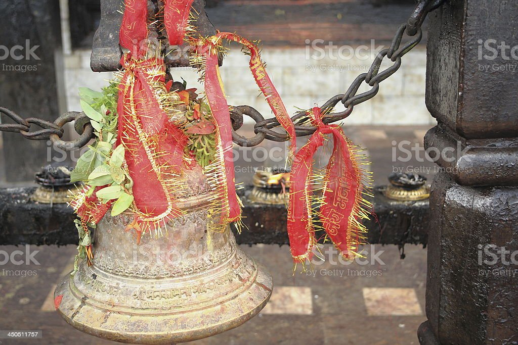 Bronze bell and red ribbon. Manakamana-Nepal. 0330 royalty-free stock photo