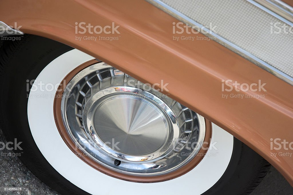 Bronze Classic Vintage Car Whitewall Tire And Silver Hubcap stock photo