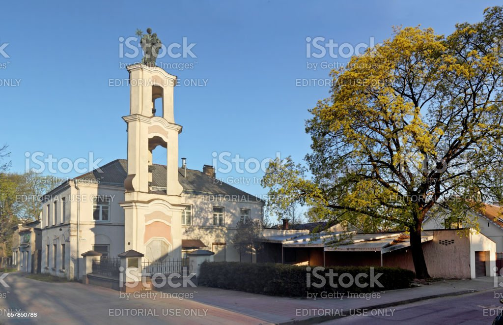 VILNIUS, LITHUANIA - MAY 04, 2016: Bronze depicts Saint Christopher with the infant Jesus in his hands statue on the Jovaro street. This coat of arms was given to Vilnius in 1330. stock photo