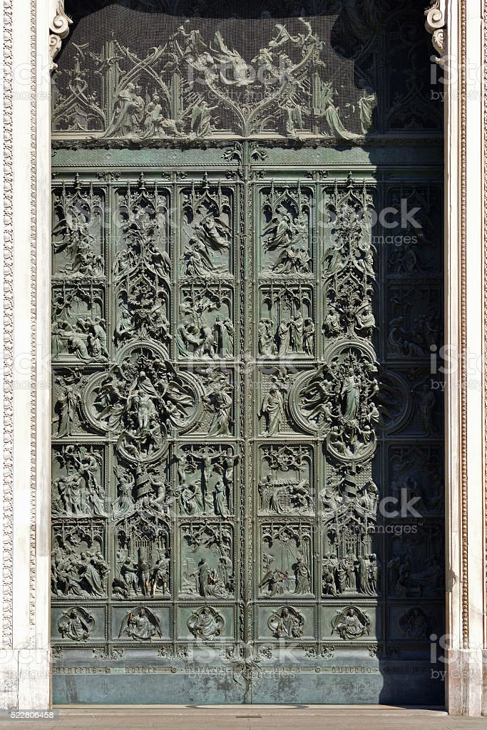 Bronze door of the Milan cathedral detail stock photo