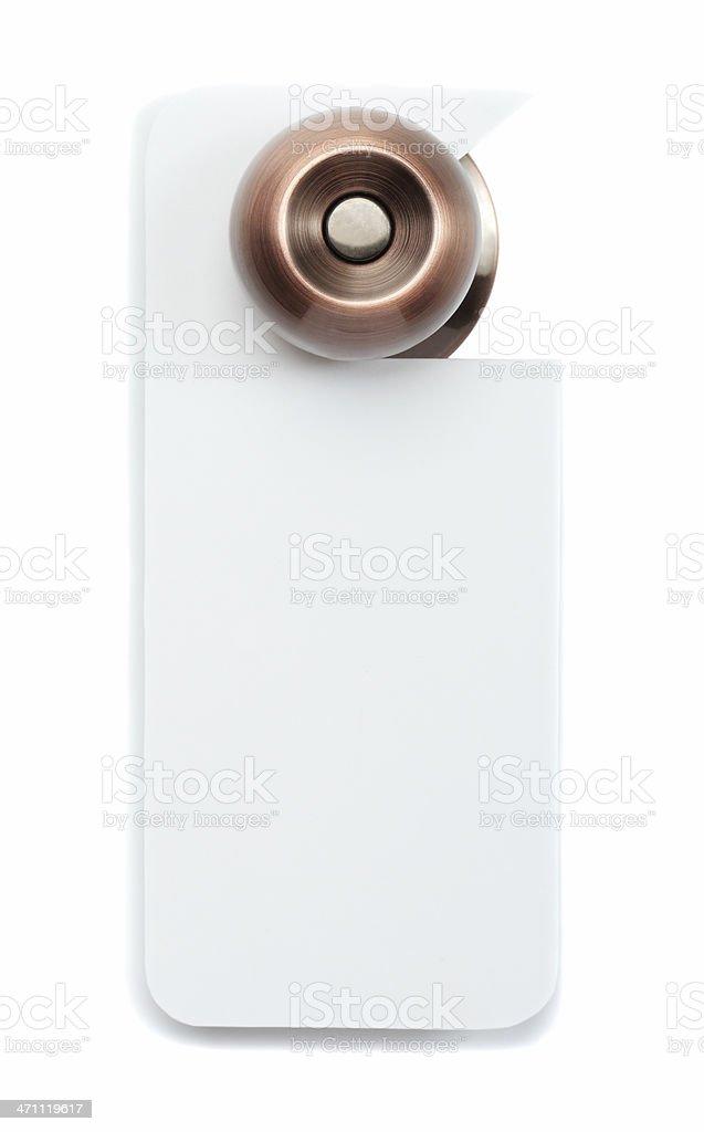 A bronze doorknob with blank white door sign stock photo