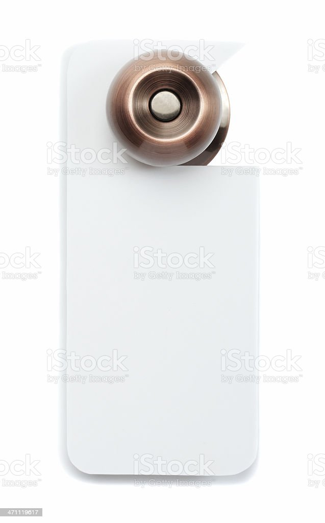 A bronze doorknob with blank white door sign stock photo