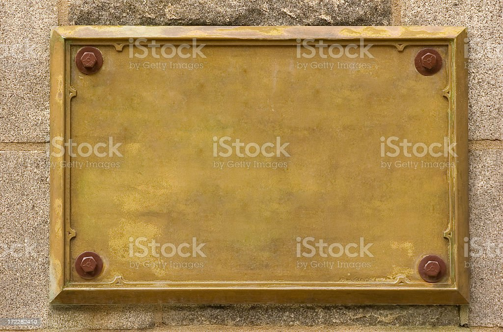 Bronze empty plaque fixed on wall stock photo