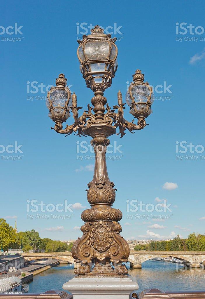 Bronze lantern on the bridge in Paris, France stock photo