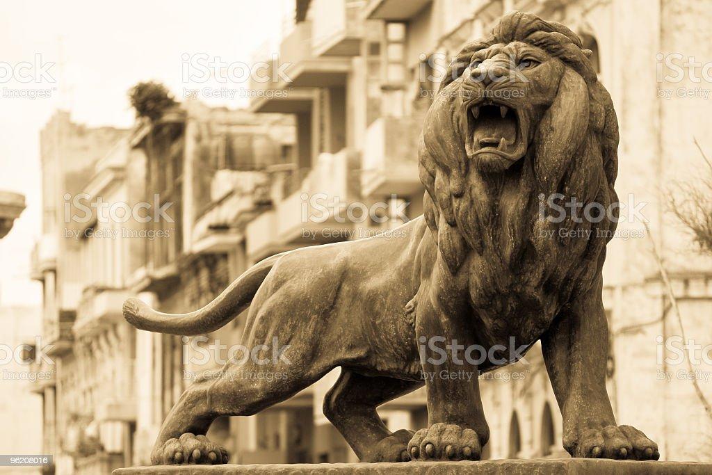 Bronze lion Old Havana (antique grayscale version) stock photo