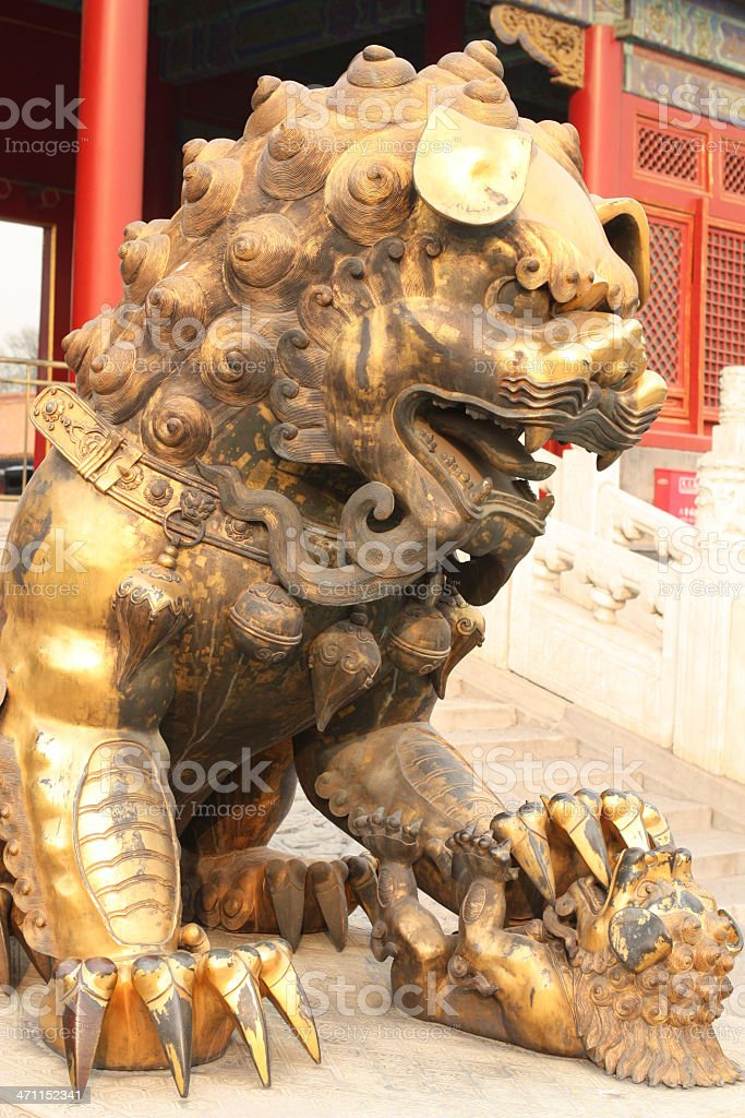 bronze lion statue in Forbiden city China stock photo