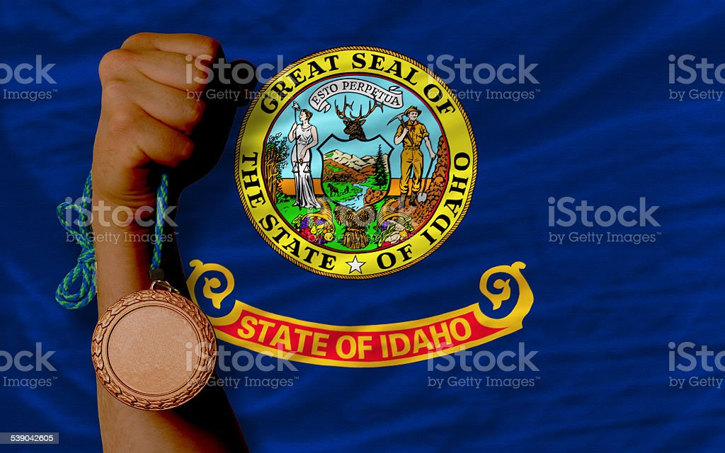 Bronze medal for sport and flag of idaho stock photo