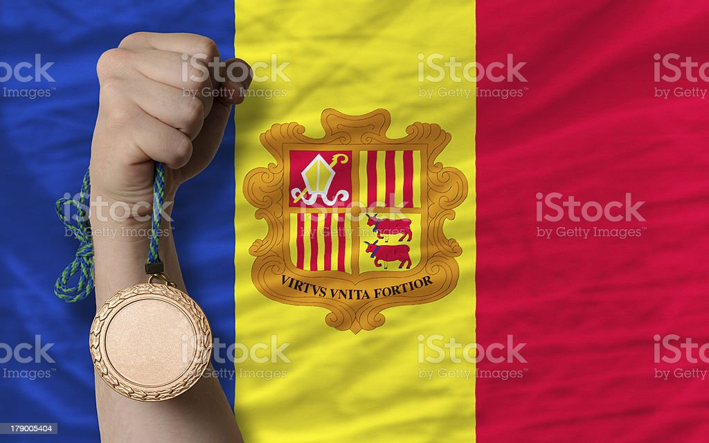 Bronze medal for sport and  national flag of andorra royalty-free stock photo