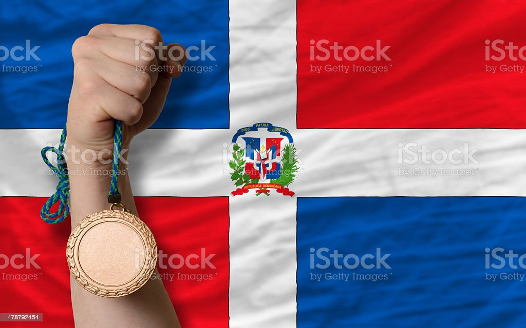 Bronze medal for sport and  national flag of dominican stock photo