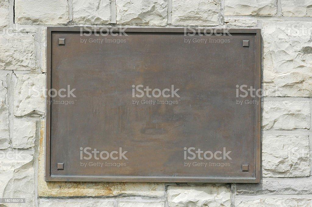 Bronze Plaque On Stone Wall stock photo