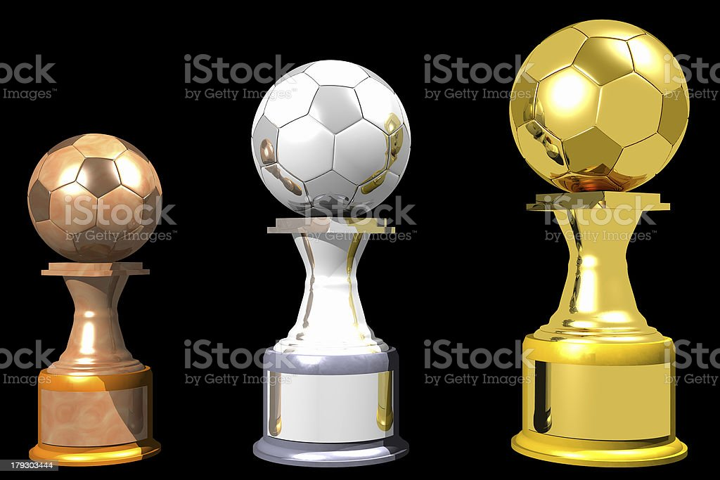 Bronze, silver and gold soccer trophies (3D) stock photo
