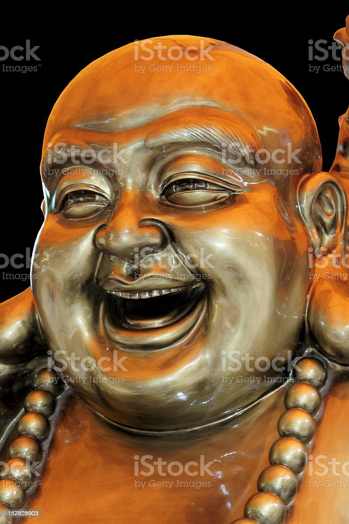 Bronze smiling buddha isolated on black stock photo