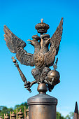 Bronze State two-headed eagle on the fence