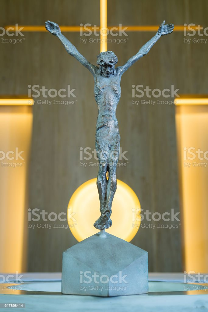Bronze Statue of Jesus Christ crucified on a cross stock photo