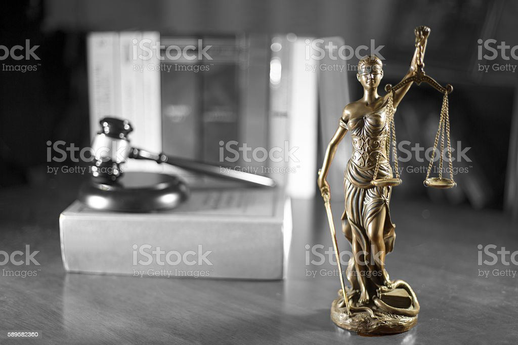 Bronze statue of Lady Justice with black and white background stock photo