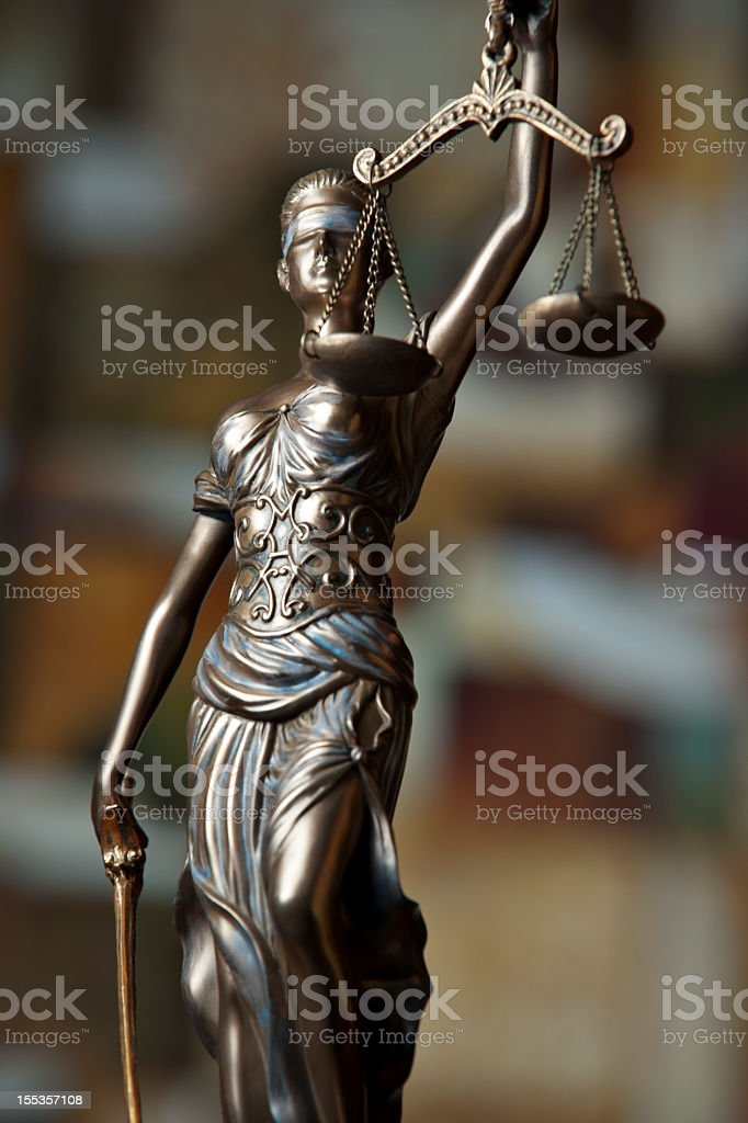 Bronze statue of Themis holding up scales stock photo