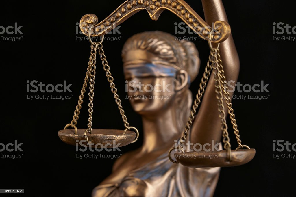 Bronze statue of Themis on a black background stock photo