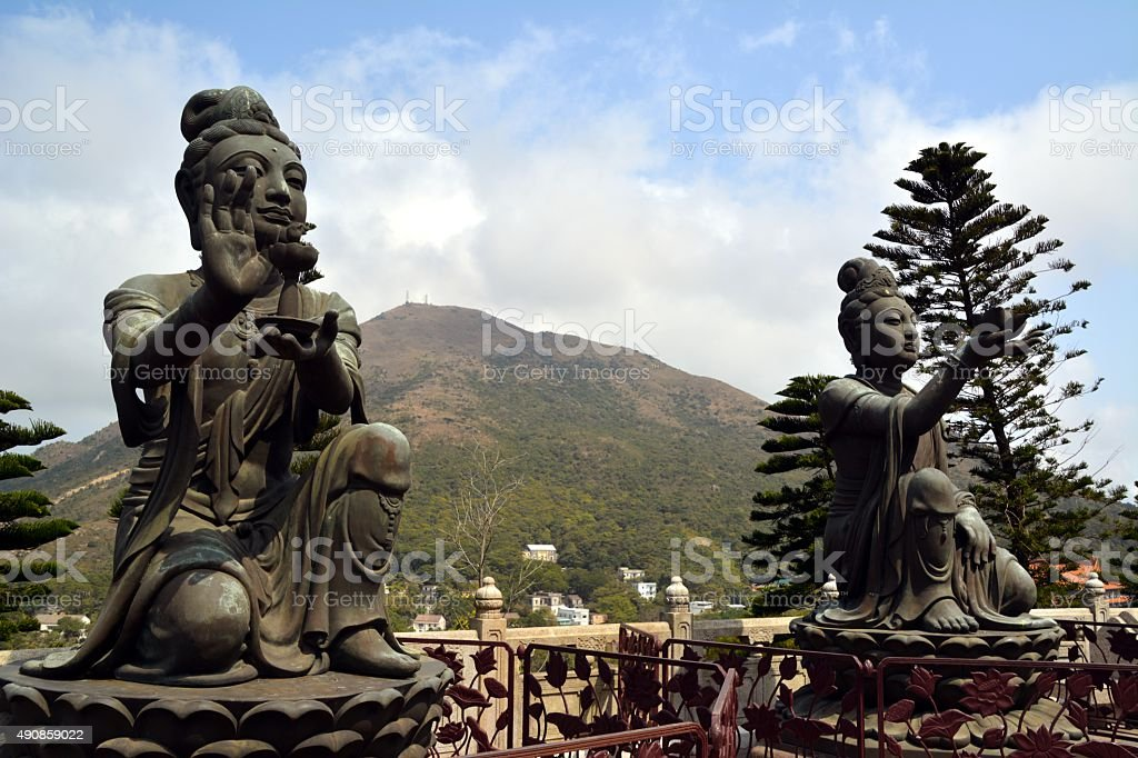 Bronze statues at the Tian Tan Buddha in Lantau island stock photo