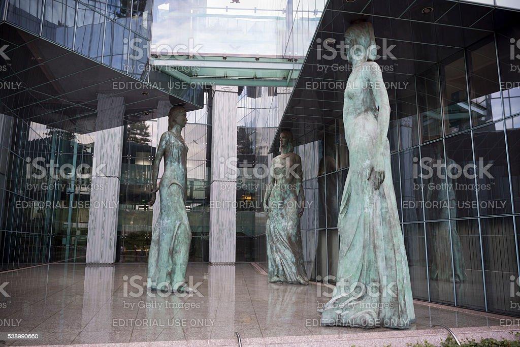 Bronze statues outside Supreme Court in Warsaw, Poland stock photo