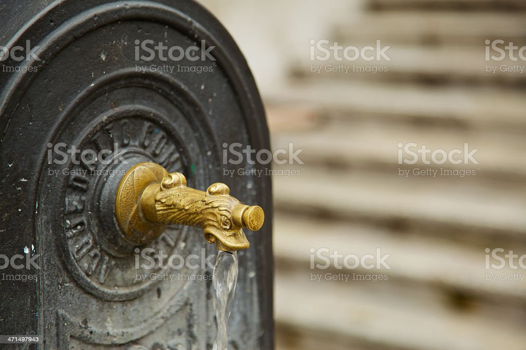 Bronze tap of public fountain. Padua-Italy stock photo