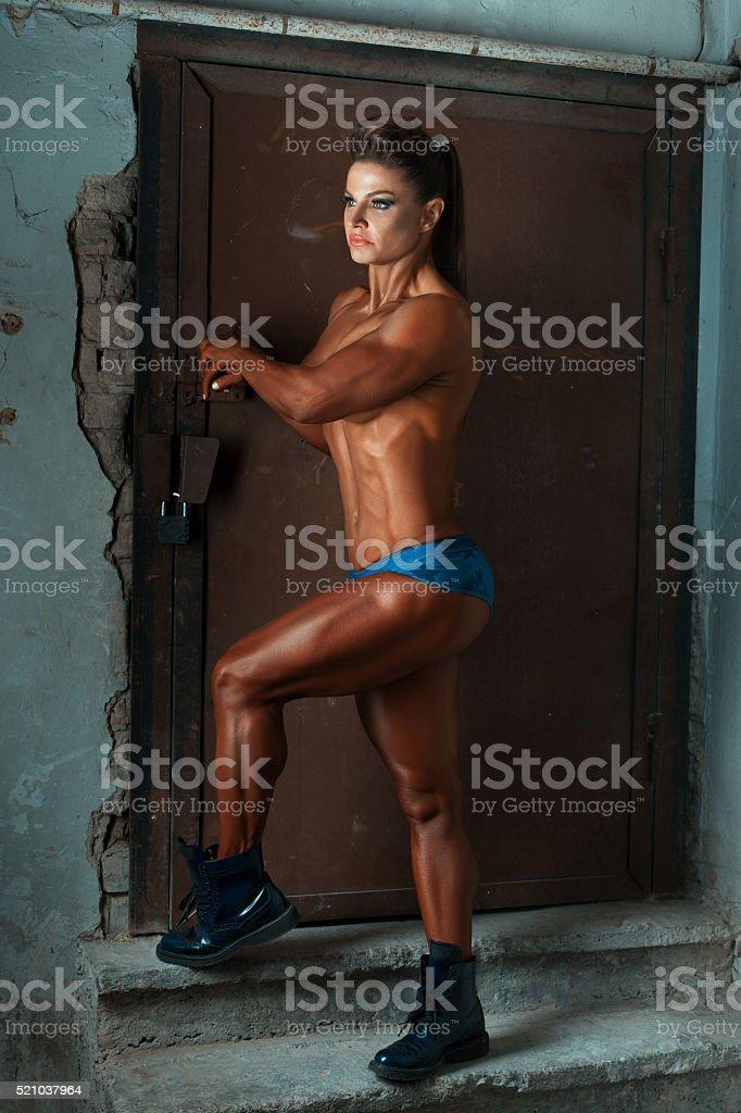 Bronze woman bodybuilder. stock photo