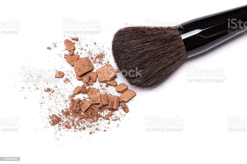Bronzing powder with makeup brush on white background stock photo