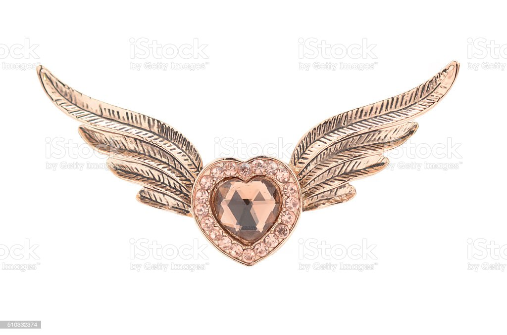 brooch in the form of a heart with wings stock photo