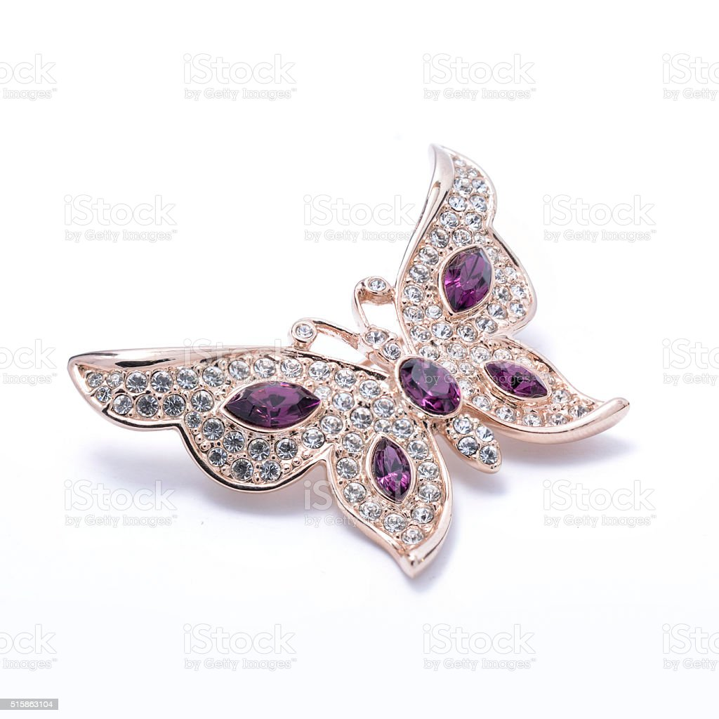 brooch in the shape of a butterfly isolated stock photo