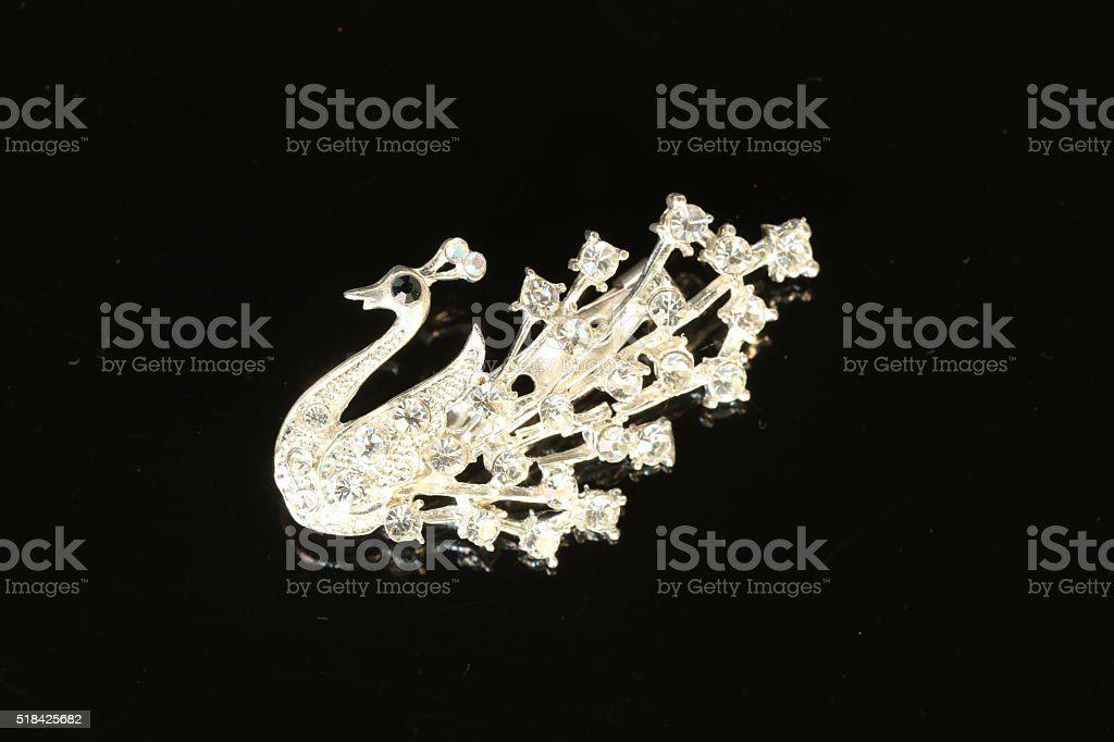 Brooch jewelry isolated on black background stock photo