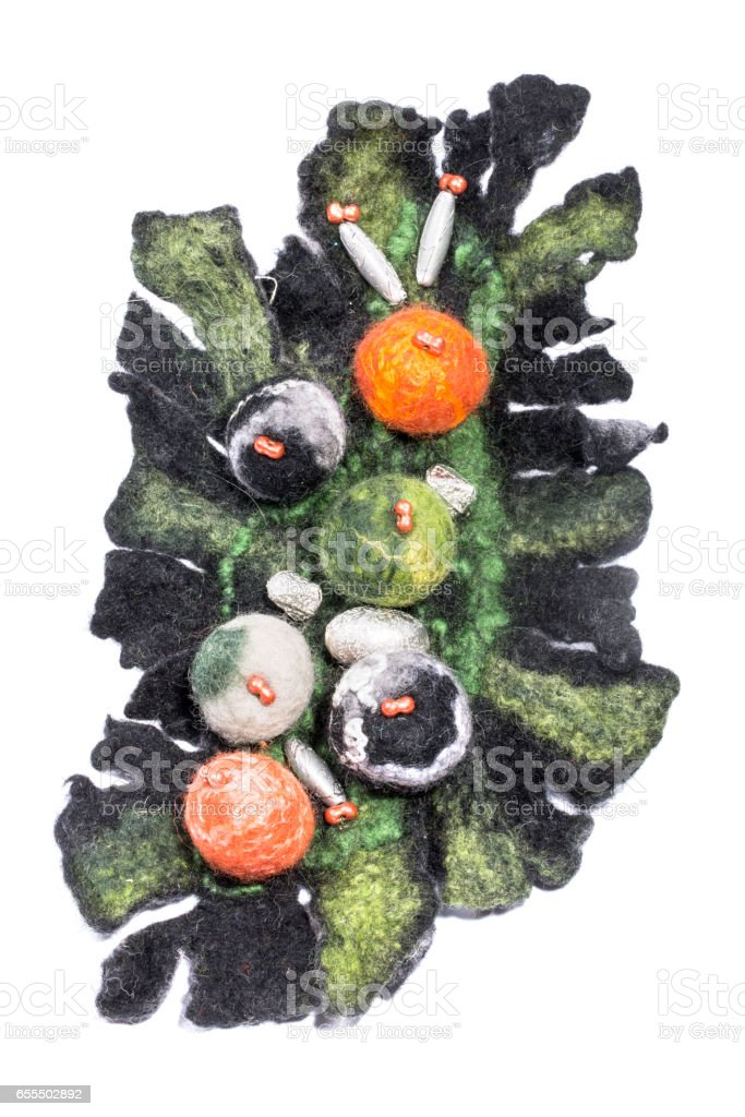 Brooch made of felted wool on a white background stock photo