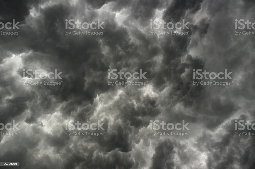Brooding grey clouds hang in a leaden sky  royalty-free stock photo