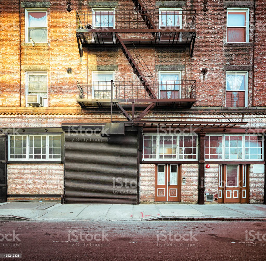 Brooklyn apartment buildings facade with large steel garage door stock photo