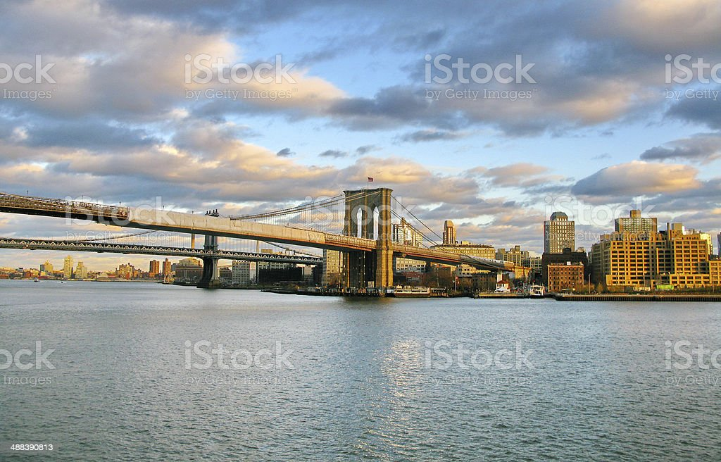 Brooklyn at sunset, from historic Pier 17. New York City stock photo